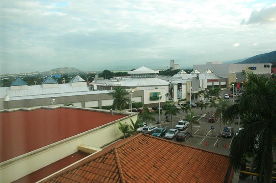 Real InterContinental San Pedro Sula at Multiplaza Mall:                   A shopping center on the left