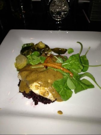 Mayan Cafe:                   Fresh Tile Fish with Black Rice andn white mole