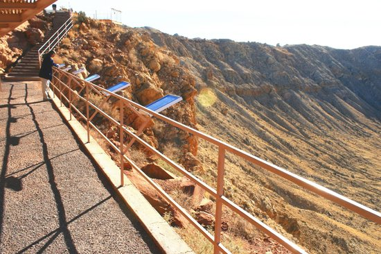 Meteor Crater:                   Railing with interpretive signage. Mostly about past mining operations.