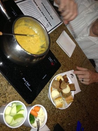 The Melting Pot:                   cheddar Cheese Fondue