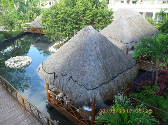 Grand Sunset Princess All Suites Resort:                   Comfy chairs in Huts to Relax at - next to center court