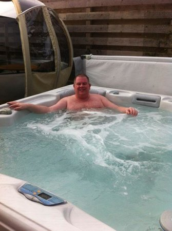 Kessock Highland Lodges:                   Relaxing in hot tub!