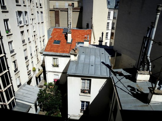 Hotel Muguet:                   A charming view of Parisian rooftops from my window