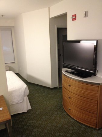 SpringHill Suites St. Louis Airport Earth City:                   TV between living & sleeping area