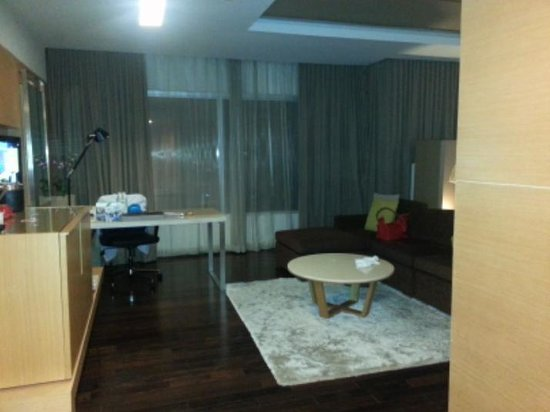Pathumwan Princess Hotel:                   mini bar, entertainment area and an office table as you open the door...