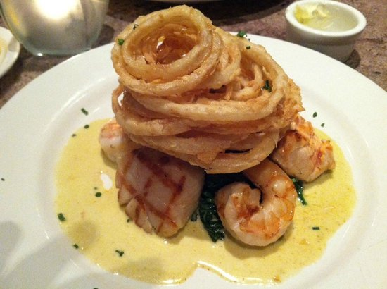 Hal's Bar & Grill :                   Mixed seafood grill (shrimp, ahi, salmon) w/ spicy sautéed spinach and onion r