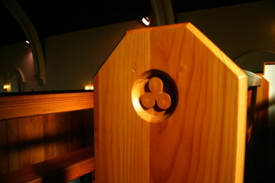 Whitehead Conservation Area: Trefoil reliefs decorate every pew in Lourdes Church.