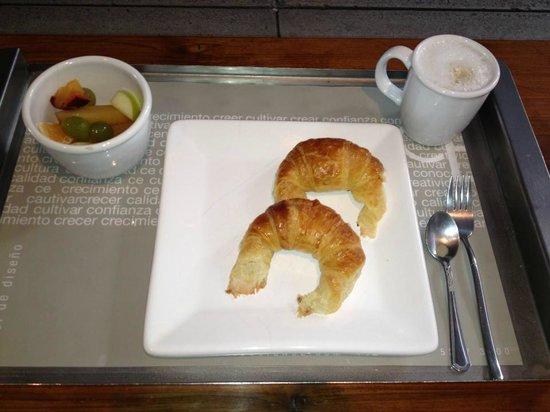 cE Hotel de Diseno: Breakfast - fruit, media lunas and cafe con leche