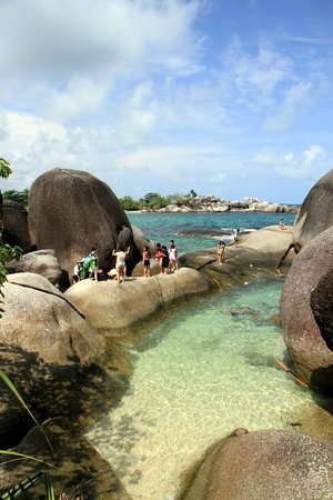Belitung Island, Indonesien:                   Tourists revel in the rock hopping at Tanjung Tinggi beach