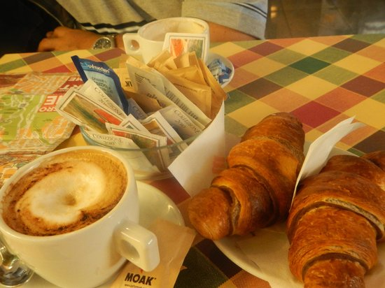 Domus RomAntica:                                     breakfast at another cafe by the corner (included)