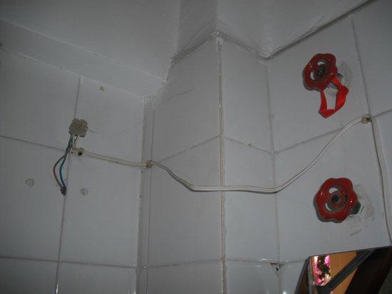 Magic Hotel:                                     Bare wiring in bathroom