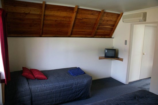 Mountain Chalet Motels:                   bedroom showing single bed (there is also a double bed in the foreground)