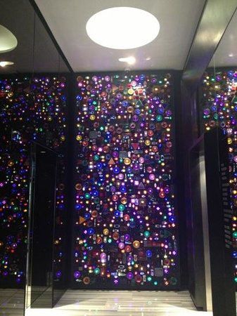 w bangkok funky wall in lift lobby made of tuk tuk lights