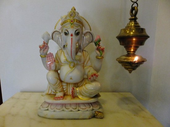 Pondicherry Executive Inn Pvt Ltd:                   Foyer Ganesh and Ghee Lamp