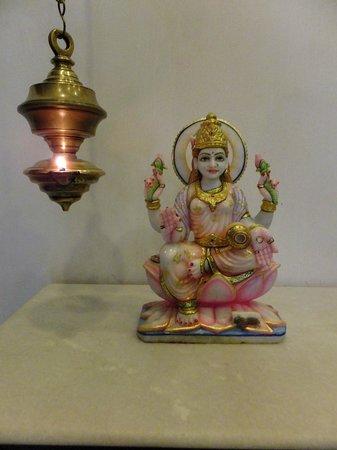 Pondicherry Executive Inn Pvt Ltd:                   Foyer Goddess with Lotus next to Ghee Lamp