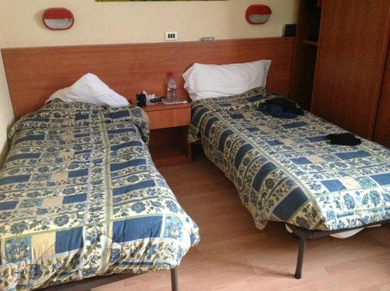 Hotel Miramonti:                   Two of the beds, one across the wardrobe