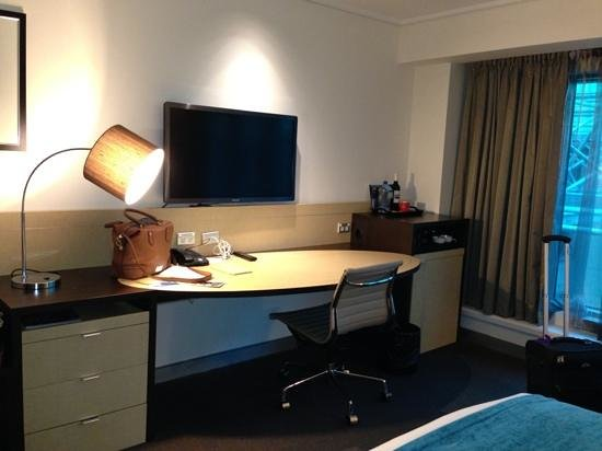 Novotel Melbourne on Collins: the desk and tv