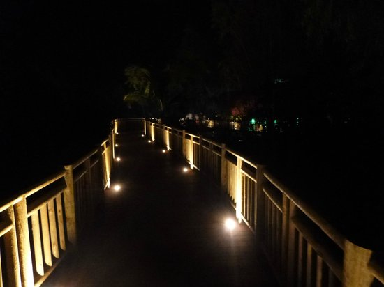 The Grand Mayan at Vidanta Nuevo Vallarta: wooden walkways to Santuario at night