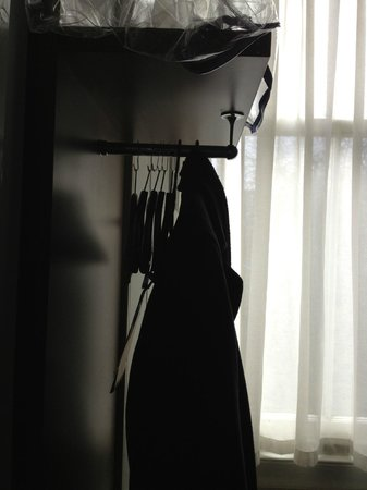 Piries Hotel: This is the only storage room for clothes~ a few hangers on an open rail