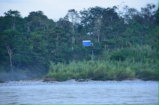 Cotococha Amazon Lodge: View of highway sign directly across river from our cabin.