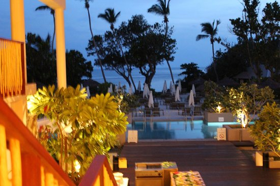 Kempinski Seychelles Resort:                   pool and beach area at sunset