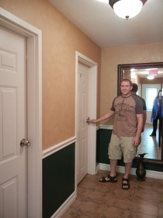 Two Rivers Bed & Breakfast: My husband going into our room