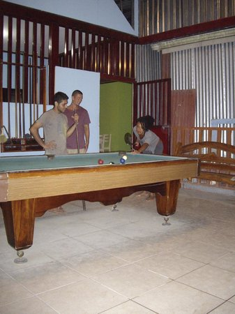 Santa Teresa Hostel:                   chilling out playing pool after a good day on the beach
