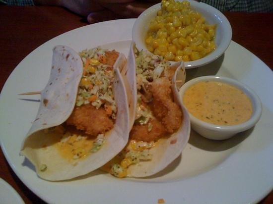fish tacos with a side of corn chipotle tartar sauce