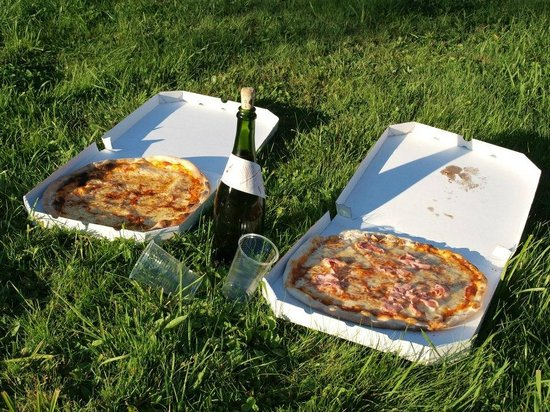 Pizzeria Italia: take-away pizza (the one on the left was burnt on the bottom and even on the top)