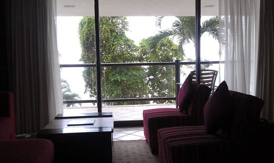Hyatt Ziva Puerto Vallarta: The view from our bed. A large tree blocks the way, but once on the balcony you can still see fa