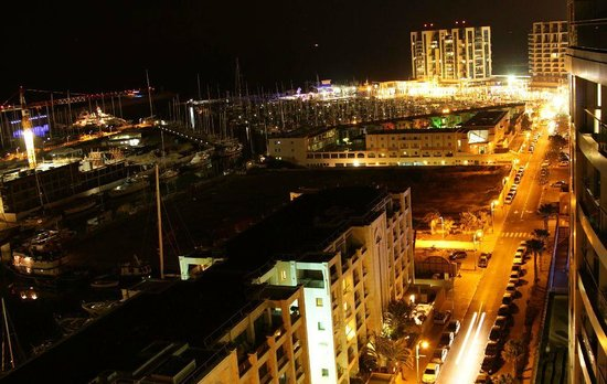 Okeanos Bamarina Exclusive Suites Hotel: View of the marina at night