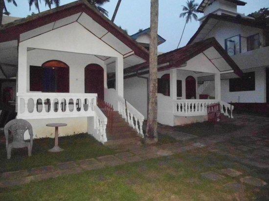 Jagabay Resort: Blick vom Garten auf die Cabana