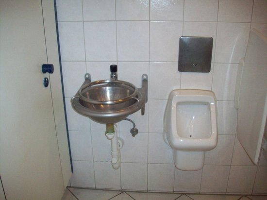 Gasthof Fraundorfer: Restaurant toilet equipped with a vomit sink