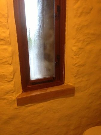 The Old Barn Bed and Breakfast:                                                       modern window but behind and old old stone