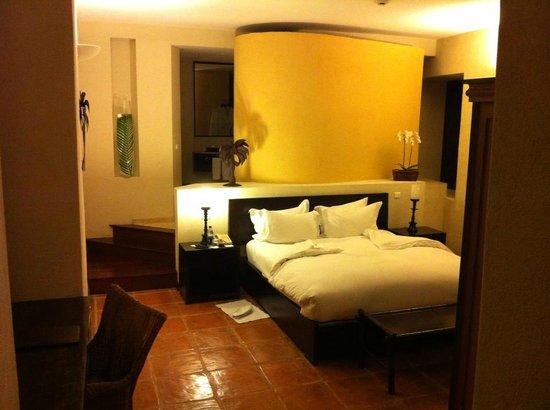 Hostal Nicolas de Ovando Santo Domingo - MGallery Collection: My beautiful room, seen from the door. Bathroom behind yellow wall.