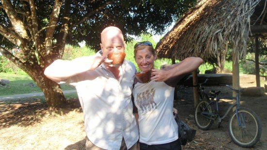 Cayequest Private Tours: Me and Teresa with our traditional salute, drinking cacao wine at the Maya site!