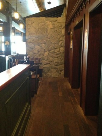 McCarthy & Bailey's Irish Pub: View from larger snug towards stone fireplace