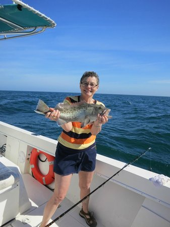 Teresa with her grouper picture of bent charters for Madeira beach fishing charters