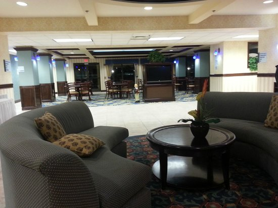 Holiday Inn Express Hotel & Suites Jacksonville South:                   Lobby with buffet area to the back