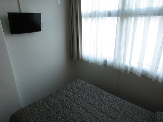 Econo Lodge City Central:                   Wall-mounted small TV
