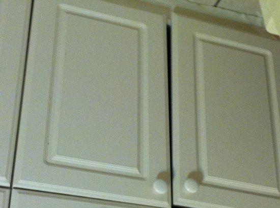 Bonefish Resort : Mis-hung Kitchenette Cupboard Door. Feb 2013