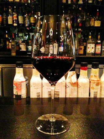 Capital Bar and Grill : Sitting and the bar with a nice glass of a big red