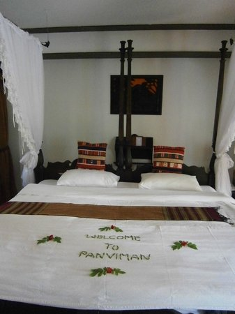 Santhiya Tree Koh Chang Resort: The bed was prepared like this when we arrived. What a lovely greeting!