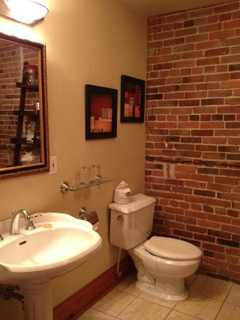 Auberge Du Vieux Port: Bathroom With Exposed Brick