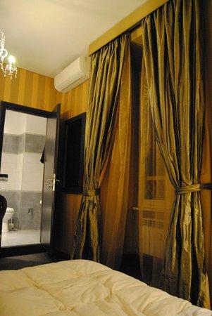 Roman Holidays: Bedroom going into bathroom