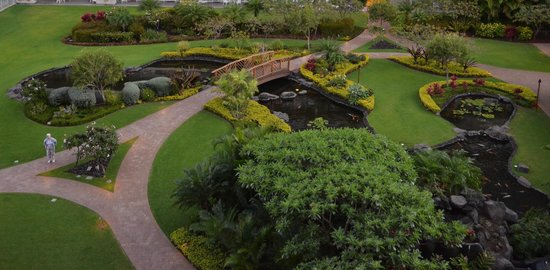 Aston at The Whaler on Kaanapali Beach: Looking down at the koi pond, this separates the two buildings