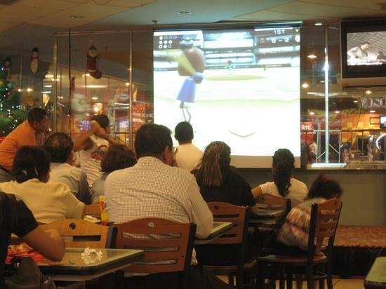 Cocina de Doña Haydée: watching kids play Wii in the food court while we ate