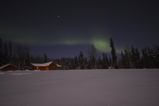 A Taste of Alaska Lodge: View of aurora above the cabin