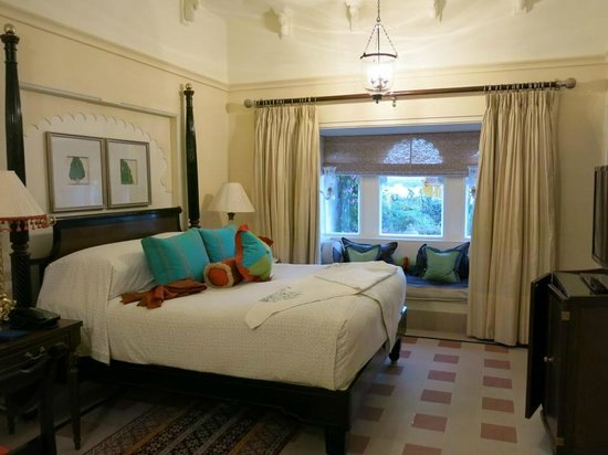 The Oberoi Udaivilas: The semi-private pool suite, very large bedroom with a lovely nook overlooking the poll & the la