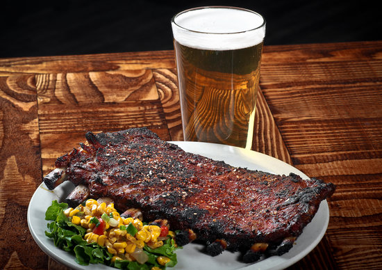 Alamo Smokehouse: We barbecue our ribs, a process of how they're cooked, not just smothered in sauce!  But, our sa
